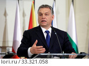 Prague, Czech Republic - February 15, 2016: The Prime Ministers of Hungary Viktor Orban is speaking during a press conference after meeting of The Visegrad Group (V4) in Prague, Czech Republic. Стоковое фото, фотограф Zoonar.com/Cylonphoto / age Fotostock / Фотобанк Лори