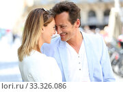 Купить «Fancy romantic couple in town embracing each other», фото № 33326086, снято 9 апреля 2020 г. (c) PantherMedia / Фотобанк Лори