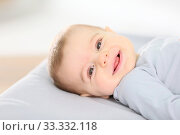 Купить «Portrait of smiling baby boy laying on changing table», фото № 33332118, снято 7 июля 2020 г. (c) PantherMedia / Фотобанк Лори