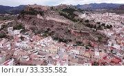 Купить «Aerial view of Sagunto city and antique roman fortress, Valencia, Spain», видеоролик № 33335582, снято 19 марта 2019 г. (c) Яков Филимонов / Фотобанк Лори