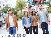 Купить «Group of friends walking in street and having fun», фото № 33335634, снято 6 апреля 2020 г. (c) PantherMedia / Фотобанк Лори