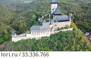 Купить «View of medieval castle Karlstejn Castle. Czech Republic», видеоролик № 33336766, снято 10 октября 2019 г. (c) Яков Филимонов / Фотобанк Лори