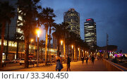 view of Barcelona beach with Mapfre tower and Arts Hotel in Barcelona in night (2019 год). Редакционное видео, видеограф Яков Филимонов / Фотобанк Лори