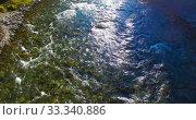 Купить «Low altitude flight over fresh fast mountain river with rocks at sunny summer morning.», видеоролик № 33340886, снято 7 апреля 2019 г. (c) Александр Маркин / Фотобанк Лори