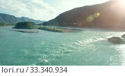 Купить «Low altitude flight over fresh fast mountain river with rocks at sunny summer morning.», видеоролик № 33340934, снято 25 марта 2019 г. (c) Александр Маркин / Фотобанк Лори