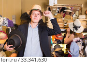 Купить «portrait of young guy try on panama at headwear store», фото № 33341630, снято 2 мая 2017 г. (c) Яков Филимонов / Фотобанк Лори