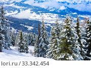 Купить «Valley behind snow covered fir forest French Alps», фото № 33342454, снято 2 марта 2019 г. (c) Сергей Новиков / Фотобанк Лори