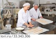 Купить «Female baker kneading a dough», фото № 33343306, снято 28 мая 2020 г. (c) Яков Филимонов / Фотобанк Лори