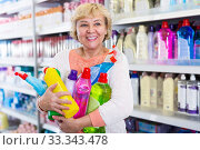 Female holding goods for cleaning in household store. Стоковое фото, фотограф Яков Филимонов / Фотобанк Лори