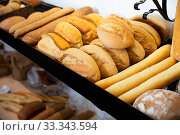Delicious and fresh bread products lying on counter in bakery. Стоковое фото, фотограф Яков Филимонов / Фотобанк Лори