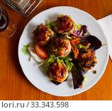 Купить «Baked mushrooms stuffed with vegetables, ham and mozzarella», фото № 33343598, снято 4 апреля 2020 г. (c) Яков Филимонов / Фотобанк Лори