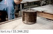 Купить «Concrete industry - man worker putting concrete in the form and ramming it with vibrations», видеоролик № 33344202, снято 5 июня 2020 г. (c) Константин Шишкин / Фотобанк Лори