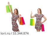 Купить «Young woman after shopping isolated on the white», фото № 33344874, снято 16 октября 2014 г. (c) Elnur / Фотобанк Лори