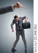 Businessman puppet being manipulated by boss. Стоковое фото, фотограф Elnur / Фотобанк Лори