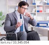 Купить «Disabled businessman working in the office», фото № 33345054, снято 6 апреля 2017 г. (c) Elnur / Фотобанк Лори