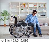 Купить «Young student on wheelchair in disability concept», фото № 33345098, снято 6 апреля 2017 г. (c) Elnur / Фотобанк Лори