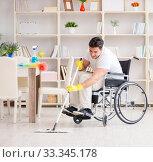 Купить «Disabled man cleaning floor at home», фото № 33345178, снято 7 апреля 2017 г. (c) Elnur / Фотобанк Лори