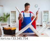 Купить «Super hero repairman working at home», фото № 33345754, снято 23 декабря 2016 г. (c) Elnur / Фотобанк Лори