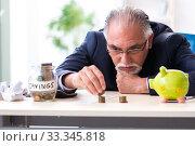 Купить «Old male accountant in budget planning concept», фото № 33345818, снято 12 сентября 2019 г. (c) Elnur / Фотобанк Лори