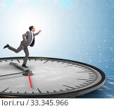 Купить «Businessman in time management concept», фото № 33345966, снято 1 апреля 2020 г. (c) Elnur / Фотобанк Лори