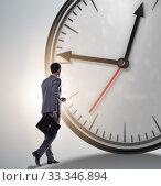 Купить «Businessman in time management concept», фото № 33346894, снято 1 апреля 2020 г. (c) Elnur / Фотобанк Лори