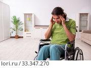 Купить «Young male invalid in wheel-chair suffering at home», фото № 33347270, снято 23 июля 2019 г. (c) Elnur / Фотобанк Лори