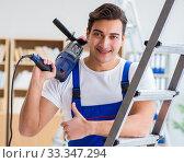 Купить «Repairman working with drilling drill perforator», фото № 33347294, снято 9 декабря 2016 г. (c) Elnur / Фотобанк Лори