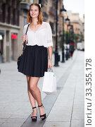 Купить «positive female walking at the modern street», фото № 33355178, снято 4 апреля 2020 г. (c) Яков Филимонов / Фотобанк Лори
