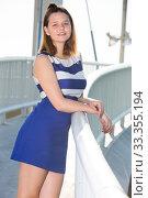 Smiling girl standing on bridge. Стоковое фото, фотограф Яков Филимонов / Фотобанк Лори