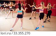 Купить «Active females dancing excited posing», фото № 33355270, снято 31 мая 2017 г. (c) Яков Филимонов / Фотобанк Лори