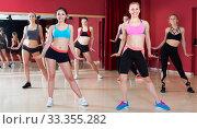 Group are practising slide movement in jazz dance. Стоковое фото, фотограф Яков Филимонов / Фотобанк Лори