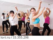 Купить «Ordinary active females exercising dance moves», фото № 33355298, снято 21 сентября 2019 г. (c) Яков Филимонов / Фотобанк Лори