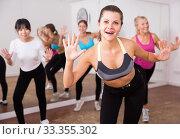 Купить «Ordinary active females exercising dance moves», фото № 33355302, снято 21 сентября 2019 г. (c) Яков Филимонов / Фотобанк Лори
