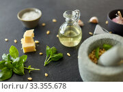 Купить «ingredients for basil pesto sauce on stone table», фото № 33355678, снято 6 сентября 2018 г. (c) Syda Productions / Фотобанк Лори