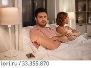 Купить «unhappy couple having conflict in bed at home», фото № 33355870, снято 6 февраля 2020 г. (c) Syda Productions / Фотобанк Лори