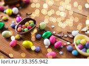 Купить «chocolate eggs and candy drops on wooden table», фото № 33355942, снято 22 марта 2018 г. (c) Syda Productions / Фотобанк Лори