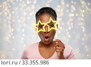 african american woman with star shaped glasses. Стоковое фото, фотограф Syda Productions / Фотобанк Лори