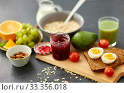Купить «jam, toast bread, eggs, avocado, cherry tomatoes», фото № 33356018, снято 1 ноября 2018 г. (c) Syda Productions / Фотобанк Лори