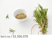 Купить «fresh and dry rosemary on white background», фото № 33356070, снято 12 июля 2018 г. (c) Syda Productions / Фотобанк Лори