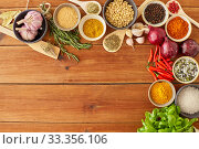 Купить «spices, onion, garlic, pine nuts and chili peppers», фото № 33356106, снято 6 сентября 2018 г. (c) Syda Productions / Фотобанк Лори