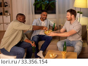 Купить «male friends drinking beer with crisps at home», фото № 33356154, снято 28 декабря 2019 г. (c) Syda Productions / Фотобанк Лори