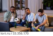 Купить «friends with ball and vuvuzela watching soccer», фото № 33356170, снято 28 декабря 2019 г. (c) Syda Productions / Фотобанк Лори