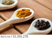 Купить «spoons with different spices on wooden table», фото № 33356278, снято 6 сентября 2018 г. (c) Syda Productions / Фотобанк Лори