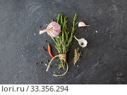 Купить «rosemary, garlic and chili pepper on stone surface», фото № 33356294, снято 6 сентября 2018 г. (c) Syda Productions / Фотобанк Лори