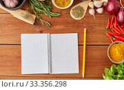Купить «notebook with pencil among spices on wooden table», фото № 33356298, снято 6 сентября 2018 г. (c) Syda Productions / Фотобанк Лори