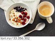 Купить «porridge breakfast with berries, almonds and spoon», фото № 33356302, снято 1 ноября 2018 г. (c) Syda Productions / Фотобанк Лори
