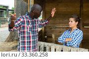 Disgruntled male farmer talking to upset wife. Стоковое фото, фотограф Яков Филимонов / Фотобанк Лори
