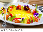 Купить «Tartar of raw salmon with ring from avocado and fresh vegetables and flowers», фото № 33360446, снято 6 июня 2020 г. (c) Яков Филимонов / Фотобанк Лори