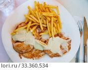 Pork steaks with fries. Стоковое фото, фотограф Яков Филимонов / Фотобанк Лори