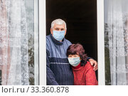 Купить «beautiful elderly couple looks out the window of a country house.», фото № 33360878, снято 29 сентября 2019 г. (c) Акиньшин Владимир / Фотобанк Лори